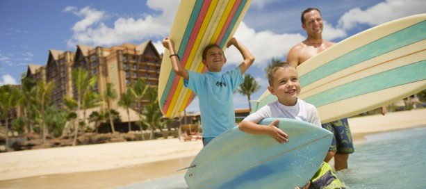 family surfing at aulani